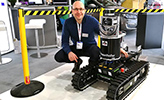 Achim Lilienthal and the robot Smokebot.