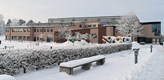 Photo of the Main Library building taken a snowy winters day