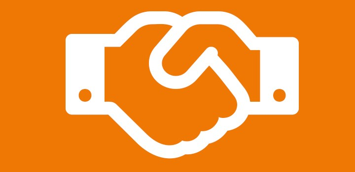 A symbol of a hand-shake on an orange background