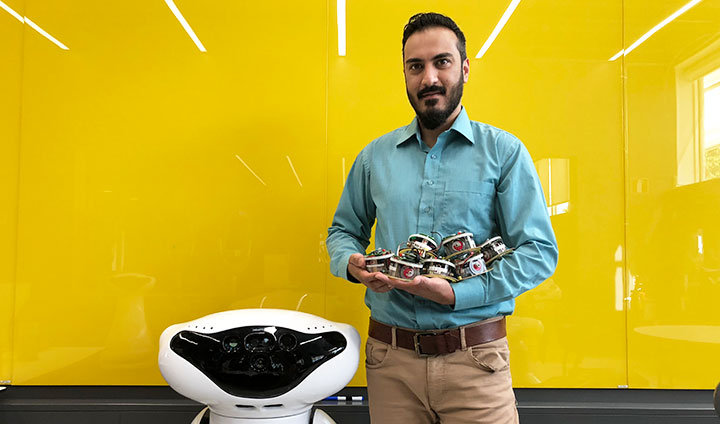 Ali Abdul Khaliq and a robot