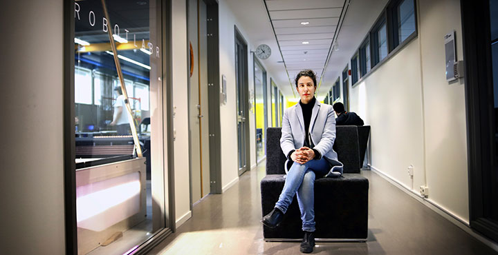 Amy Loutfi, pro-vice-chancellor for artificial intelligence at Örebro University, sits outside the Robotlab.