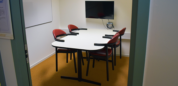 Photo of a group study room with a table and four chairs