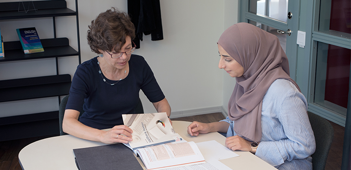 Tutor helping student with an academic text