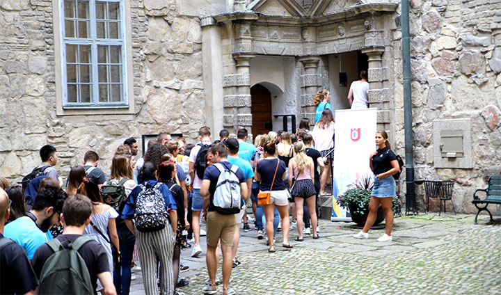Exchange students queing for a guided tour of Örebro Castle.