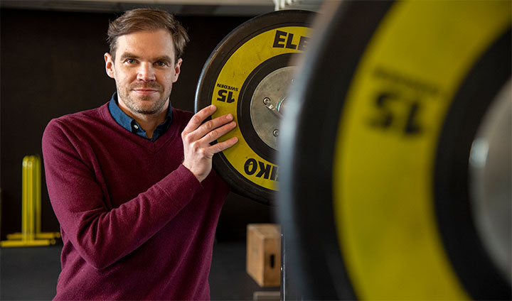 Photo of Peter Edholm, researcher at Örebro University, standing in a gym.